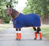 A selection of fleece rugs, cooler rugs and stable sheets
